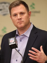 Green Bay Packers general manager Brian Gutekunst conducts
