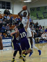 Robert E. Lee's Darius George goes up for a shot over