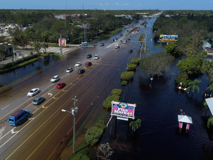 Busy roads are still covered in water Tuesday, Sept.