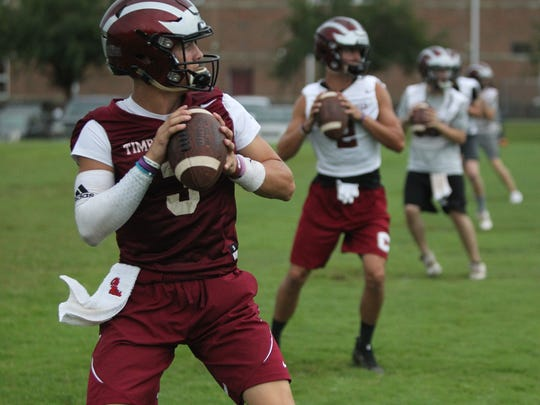 Chiles junior quarterback Garrett Greene works on a footwork drill during practice.