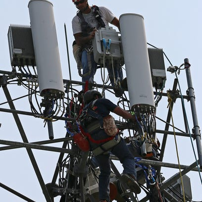 Technicians from Velex, a tower construction company