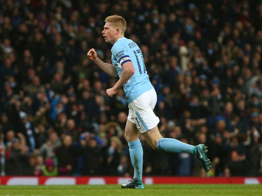 Manchester City's Kevin De Bruyne celebrates scoring his sides first goal during the English League Cup semifinal first leg soccer match between Manchester City and Bristol City at the Etihad stadium in Manchester, England, Tuesday, Jan. 9, 2018. (AP Photo/Dave Thompson)