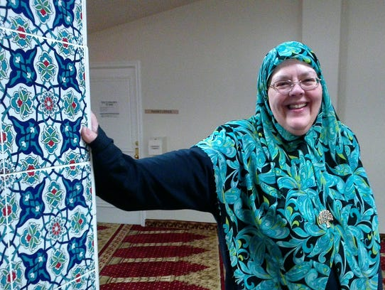 Kathy Al-Jallad, Administrator for the Islamic Organization of the Southern Tier shows tiled pillar at the mosque.