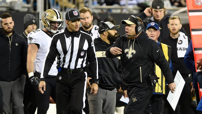 New Orleans Saints head coach Sean Payton, right, argues a call in the second half of an NFL football game against the Carolina Panthers in Charlotte, N.C., Monday, Dec. 17, 2018. (AP Photo/Mike McCarn)