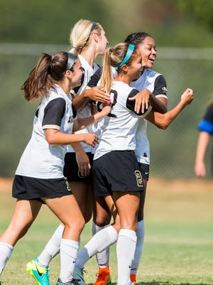 Anderson University's Emily Perez celebrates with her teammates after scoring the game winning goal in overtime against Brevard on Wednesday, September 21, 2016 in Anderson.