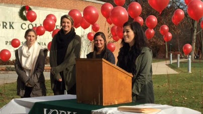 York College student Marisa Sehested speaks at a news conference about student efforts to support the Global Emergency Care Collaborative, a nonprofit organization working to provide emergency medical care to the people of Uganda.