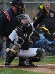 Paint Valley's Lea McFadden catches a pitch from Mikayla