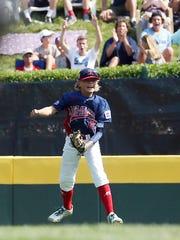 Holbrook Little League left fielder Mike Aren't celebrates