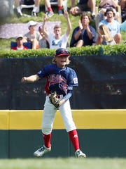 Holbrook Little League left fielder Mike Aren't celebrates an inning ending diving catch in the first inning vs. New England Region Champion of the Fairfield American Little League of Fairfield, Conn. August 17, 2016, South Williamsport, Pa.