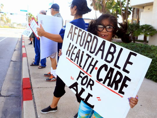 Protesters gather in front of Congressman Blake Farenthold office as they support others in the Medicare For All March on Monday, July 24, 2017, in Corpus Christi.