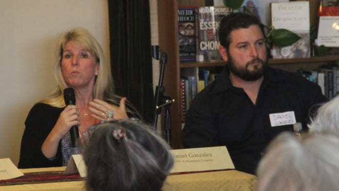Robin Ledford (left) speaks at an anti-human trafficking workshop Saturday alongside Daniel Gonzalez. Ledford and Gonzalez are with the YWCA, which opened Monterey County's first shelter for victims of humans trafficking.