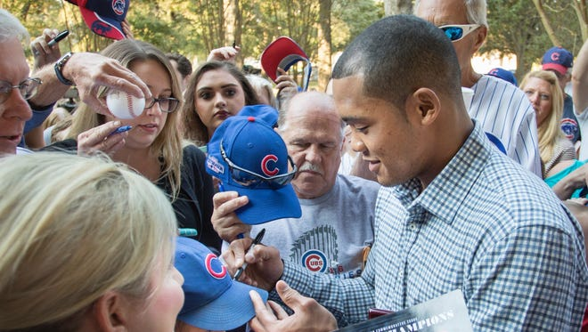 Chicago Cub and Pace High graduate Addison Russell signs autographs Tuesday after receiving keys to the city of Pensacola.