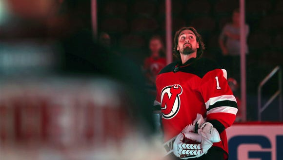 New Jersey Devils goalie Keith Kinkaid (1) stands on