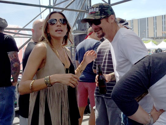 Jana Kramer and Kid Rock on the side stage during Drake