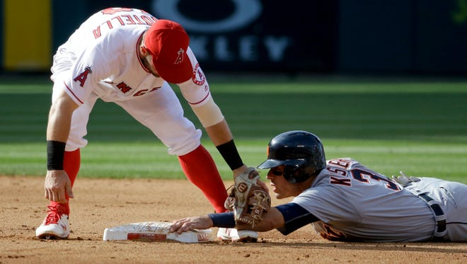 Detroit Tigers' Ian Kinsler steals second past Los Angeles Angels second baseman Johnny Giavotella during the fifth inning.