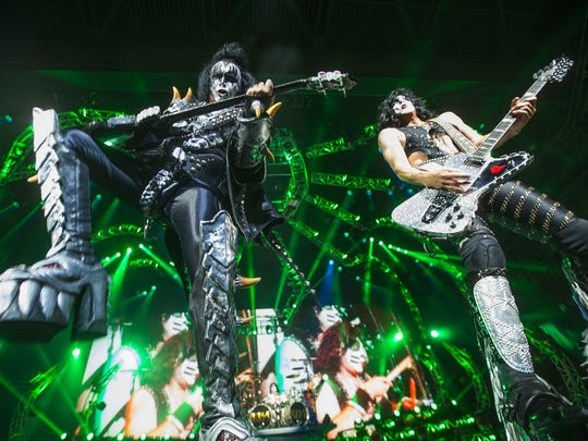 Gene Simmons (left) and Paul Stanley perform with Kiss for fans at Ak-Chin Pavilion in Phoenix July 9, 2014.