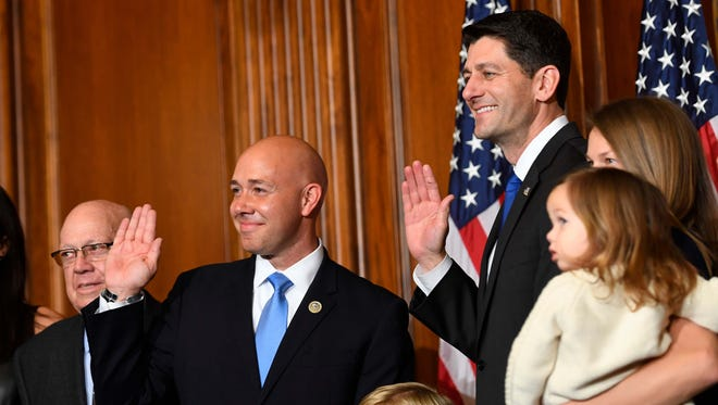 Jan 3, 2017; Washington, DC, USA;  Brian Mast, R-Florida, stands with House Speaker Paul Ryan, R-Wisconsin, for a ceremonial swearing-in and photo-op during the opening session of the 115th Congress.  Mandatory Credit: Jack Gruber-USA TODAY NETWORK