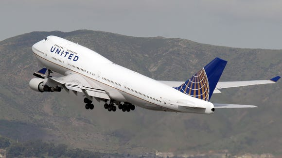 A United Airlines 747-400 takes off for South Korea