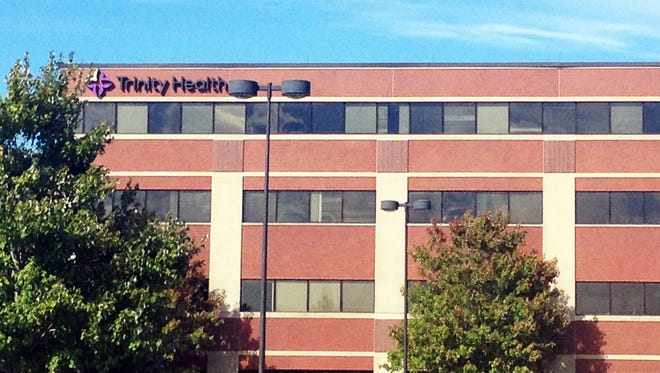 The American Civil Liberties Union is suing Trinity Health Corporation in Livonia, Mich., whose headquarters is shown here, alleging that the Catholic health system put women in danger by failing to perform emergency abortions.