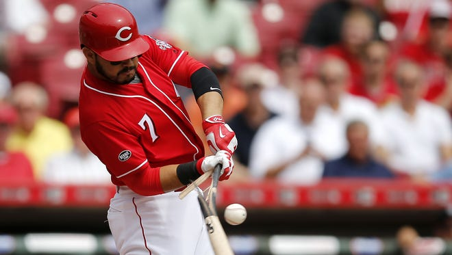 Cincinnati Reds third baseman Eugenio Suarez (7) breaks his bat on a ground out in the first inning during a game between the Colorado Rockies and the Cincinnati Reds, Wednesday, April 20, 2016, at Great American Ball Park in Cincinnati.