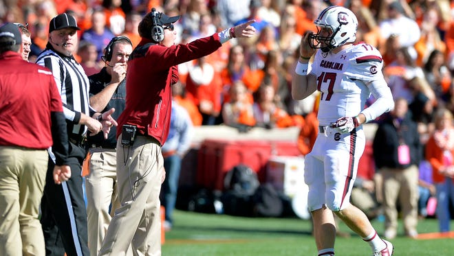 USC quarterbacks coach G.A. Mangus gets after USC quarterback Dylan Thompson (17) at Memorial Stadium on Saturday, November 29, 2014.