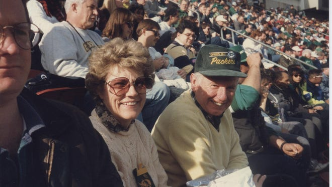 Green Bay natives Joan and Jack Kaster watch the Green Bay Packers play the New York Jets at Meadowlands Stadium in New Jersey in the early 1990s.