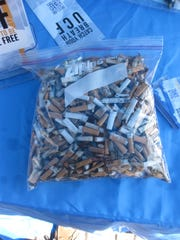 A Ziploc bag stuffed full of cigarette butts collected