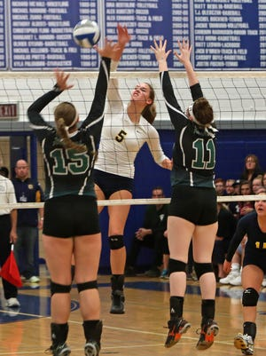 Walter Panas' Yvette Burcescu (5) gets a shot by Yotrktown's Toni Fiore (15) and Taryn Frawley (11) during the Section 1 Class A playoff championship volleyball game at Hendrick Hudson High School in Montrose Nov 6, 2015.