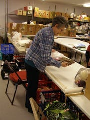 Volunteer Kathy White organizes some donations.