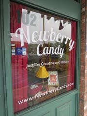 """A miniature version of the lamp seen in the movie """"A Christmas Story"""" is part of the front-window display at Newberry Candy in Thousand Oaks."""