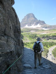 A hiker makes his way along the Highline Trail, which has been closed along with the Loop and Swiftcurrent trails in Glacier National Park due to grizzly bear activity.