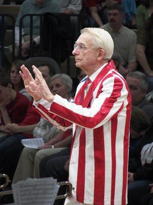 Professor Mike Leckrone leads the UW Varsity Band at Omro High School in 2010.