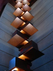 This Nov. 13, 2016 photo shows a wooden light fixture rising inside the Frank Lloyd Wright-designed Bachman-Wilson House in Bentonville, Ark.