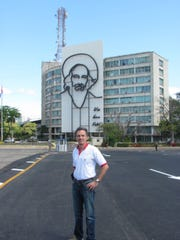"Fernando ""Fritz"" Riveron stands in front of one of the many murals throughout Cuba associated with the Cuban Revolution during his 2007 visit to his native country."