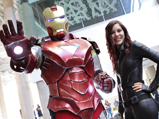 "Iron Man and Black Widow of the ""Iron Man"" and ""Avengers"" movies suit up for MegaCon in Orlando."