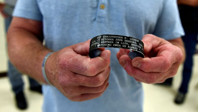 Randy Loudon holds out his bracelet that he wears to honor his son, fallen 2nd lt. Christopher Loudon, Sunday, June 11, 2017. Local chapters of Star Touring and Riding honored the Loudons over the weekend, presenting them with an Honor and Remember Flag, on Saturday, and a cavalcade to breakfast, Sunday.