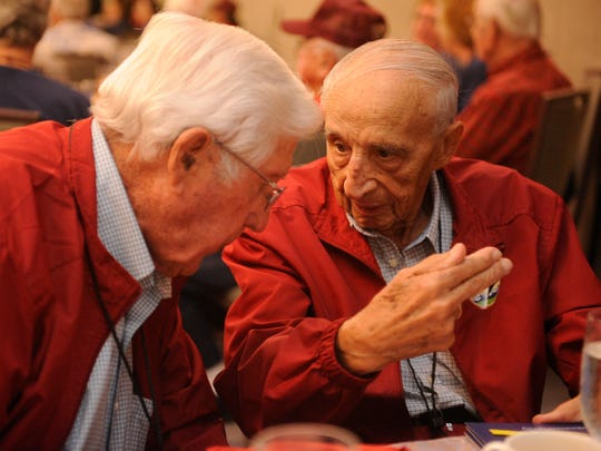 James Sheldon of Exeter, left, and Garrett Rickman of Fresno lean toward each other and talked about Europe during the war. â??We were both on bomber crews,â? Sheldon said. â??We flew our missions and came home.â? They were on the Central Valley Honor Flight that went from Fresno to Washington, D.C., this week for a 3-day tour to honor World War II veterans.