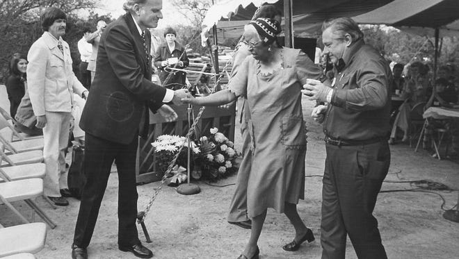 Gospel singer Ethel Waters is helped to her seat by Billy Graham, left, and Grady Wilson at a 1974 event held near Blackwell in Wilson's honor.