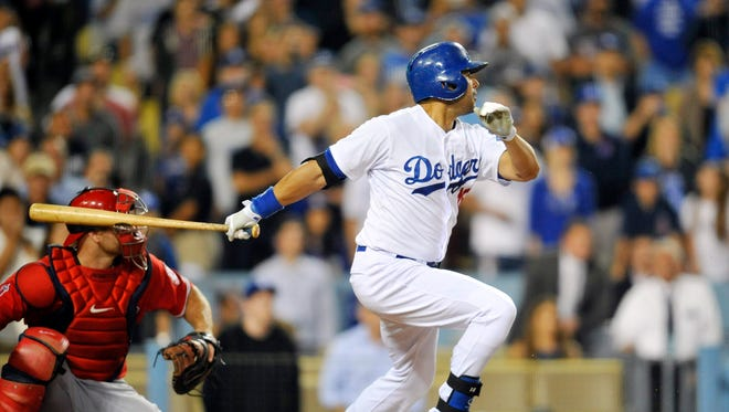 Los Angeles Dodgers center fielder Andre Ethier (16) hits a walk off RBI to bring in the winning run in the ninth inning against the Los Angeles Angels at Dodger Stadium.