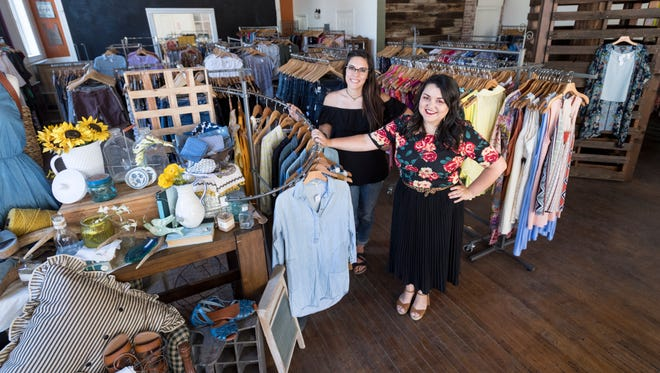 Jennifer Mejia, right, and Brittany Pacillas stand among new items in Visalia Rescue Mission's Simply Chic expansion on Tuesday, June 19, 2018. The use of the space formerly used by the Lunch Box restaurant in the old Palace Hotel in Downtown Visalia doubled their retail space. The Palace Hotel opened in 1876.