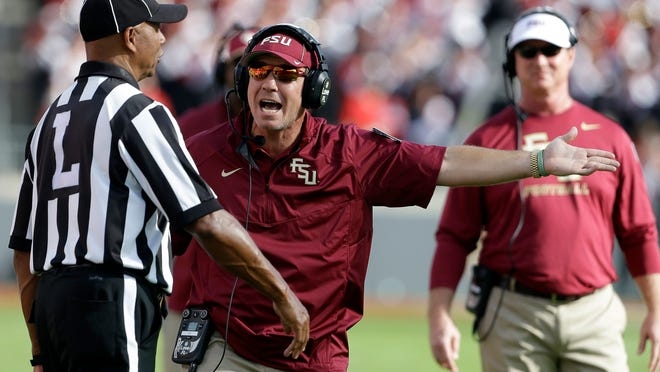 Florida State coach Jimbo Fisher argues with an official during the first half of this season's game at NC State.