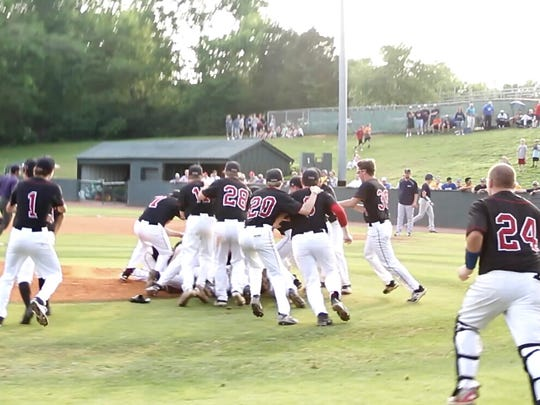 Maryville High School baseball players mob winning