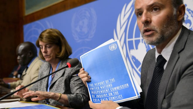 A spokesman for the Office of the High Commissioner for Human Rights, Rolando Gomez, presented the commission's report on the 2014 Gaza conflict next to Commission chairwoman Mary McGowan Davis during a news conference June 22, 2015, at the United Nations office in Geneva.