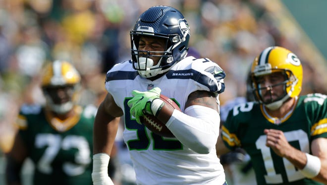 Seahawks defensive tackle Nazair Jones (92) rumbles downfield after intercepting a pass thrown by Packers quarterback Aaron Rodgers.
