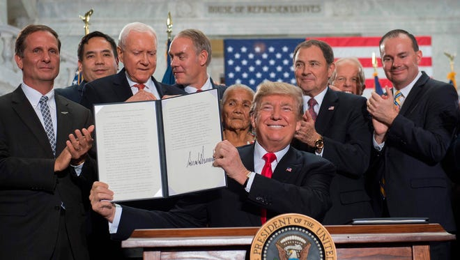 President Trump signs  proclamations shrinking Bears Ears and Grand Staircase-Escalante national monuments at the Utah State Capital in Salt Lake City, Utah Monday.