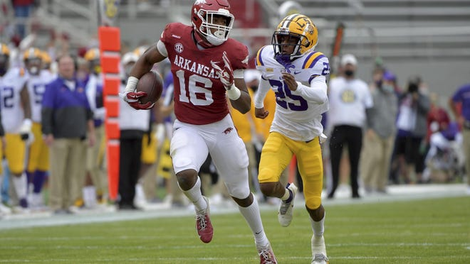 Arkansas receiver Treylon Burks (16) shakes LSU defender Cordale Flott (25) as he runs for a touchdown on Nov. 21 in Fayetteville. The Razorbacks play a COVID-19 make-up game against Mizzou on Saturday, after missing last week's game with an outbreak among Arkansas players.