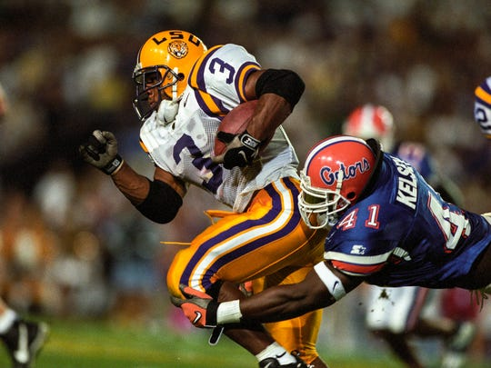 Oct 11, 1997; Baton Rouge, LA, USA; FILE PHOTO; LSU Fighting Tigers running back Kevin Faulk (3) in action against Florida Gators linebacker Keith Kelsey (41) at Tiger Stadium. Mandatory Credit: RVR Photos-USA TODAY Network