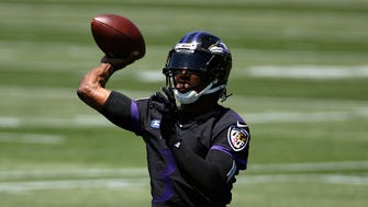 Baltimore Ravens quarterback Robert Griffin III throws a pass during an NFL football organized team activity at the team's headquarters in Owings Mills, Md., Thursday, May 24, 2018.