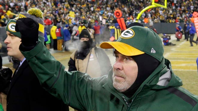 Green Bay Packers coach Mike McCarthy walks off the field after a 38-13 win over the  New York Giants in the NFC wild-card playoff football game at Lambeau Field.