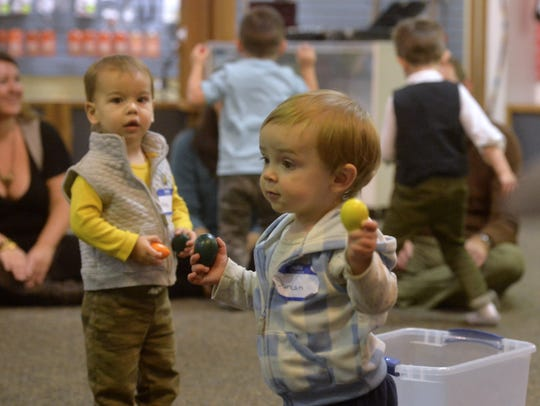 Kids dance and play music during the Small Fry Social